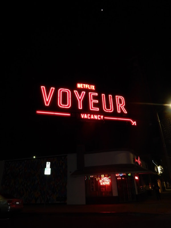 Voyeur vacancy neon sign billboard