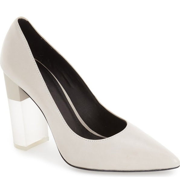 Elegant white pumps with a Lucite heel