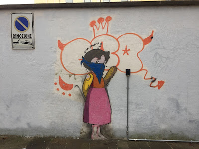 Padova Street Art - masked girl with a club