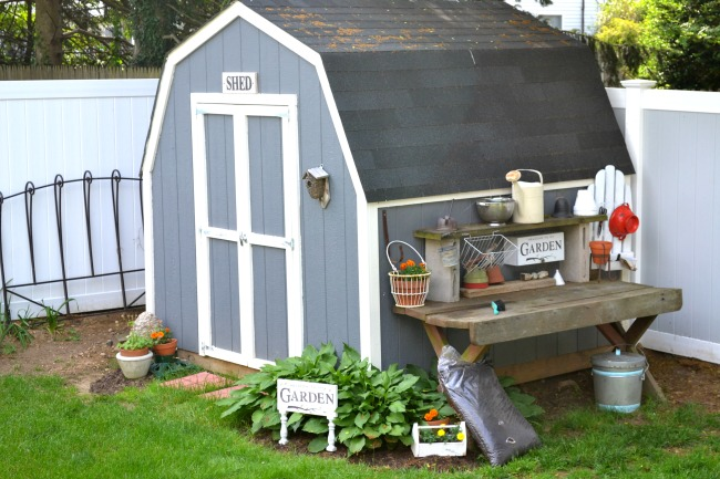 The side of the shed is the perfect place for a potting bench with repurposed organization and storage. Homeroad.net