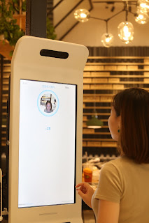 """Source: Yum China.   A customer paying using Alipay's new """"Smile to Pay"""" facial recognition payment solution in KPRO, Hangzhou, China."""