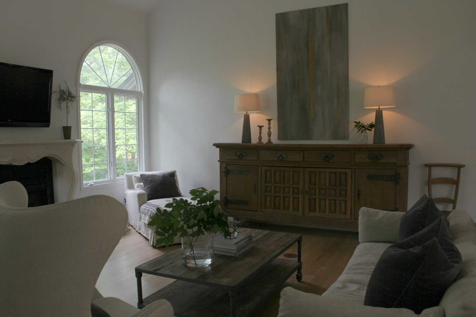 Belgian style living room huge rustic sideboard and linen upholstered furniture - Hello Lovely Studio