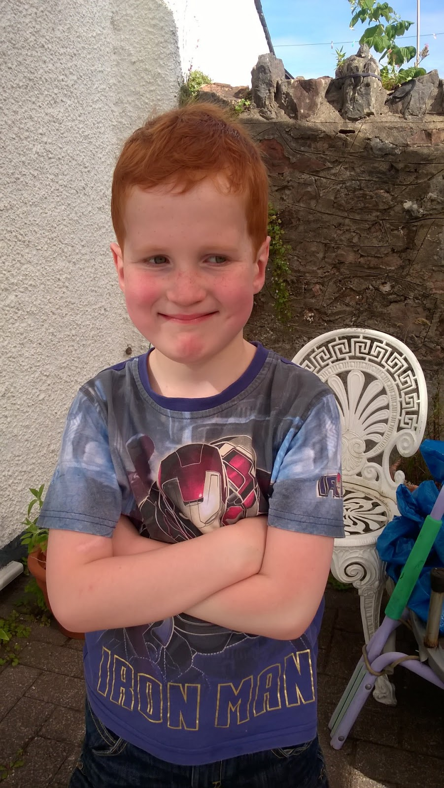 left out on a playdate - Ieuan modelling his new haircut