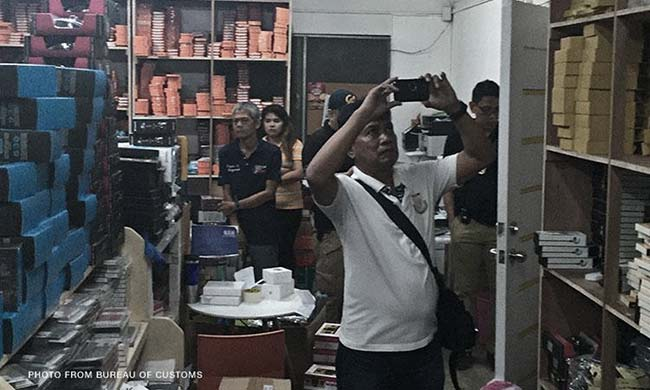Millions Worth of Alleged Smuggled Gadgets Seized from 'Kim Store' Warehouse