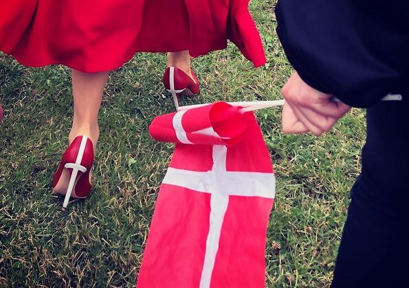 Crown Princess Mary wore Raquel Diniz Armonia silk-georgette dress. Danish flag