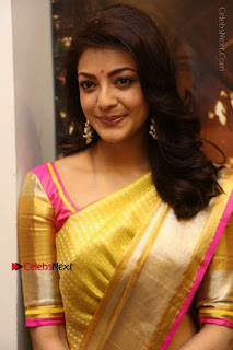 Actress Kajal Agarwal Stills in Golden Silk Saree at Trisha Sesigner Store Launch  0012.jpg