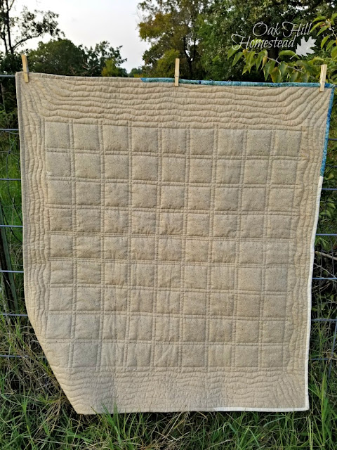 The back side of the latest baby quilt. It was my first attempt at machine quilting so I kept it simple.