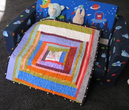 Log Cabin style Doll Quilt made entirely with scraps of fabric ~ Threading My Way