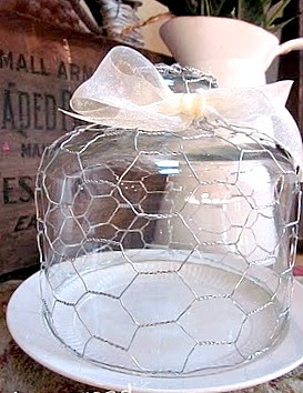 Glass cloche wrapped with chicken wire on plate
