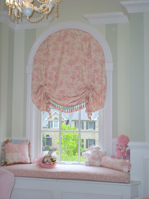 arch window treatment: pink window curtain and seat