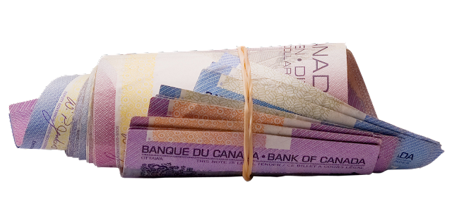 A roll of Canadian currency in different denominations, held with an elastic band.