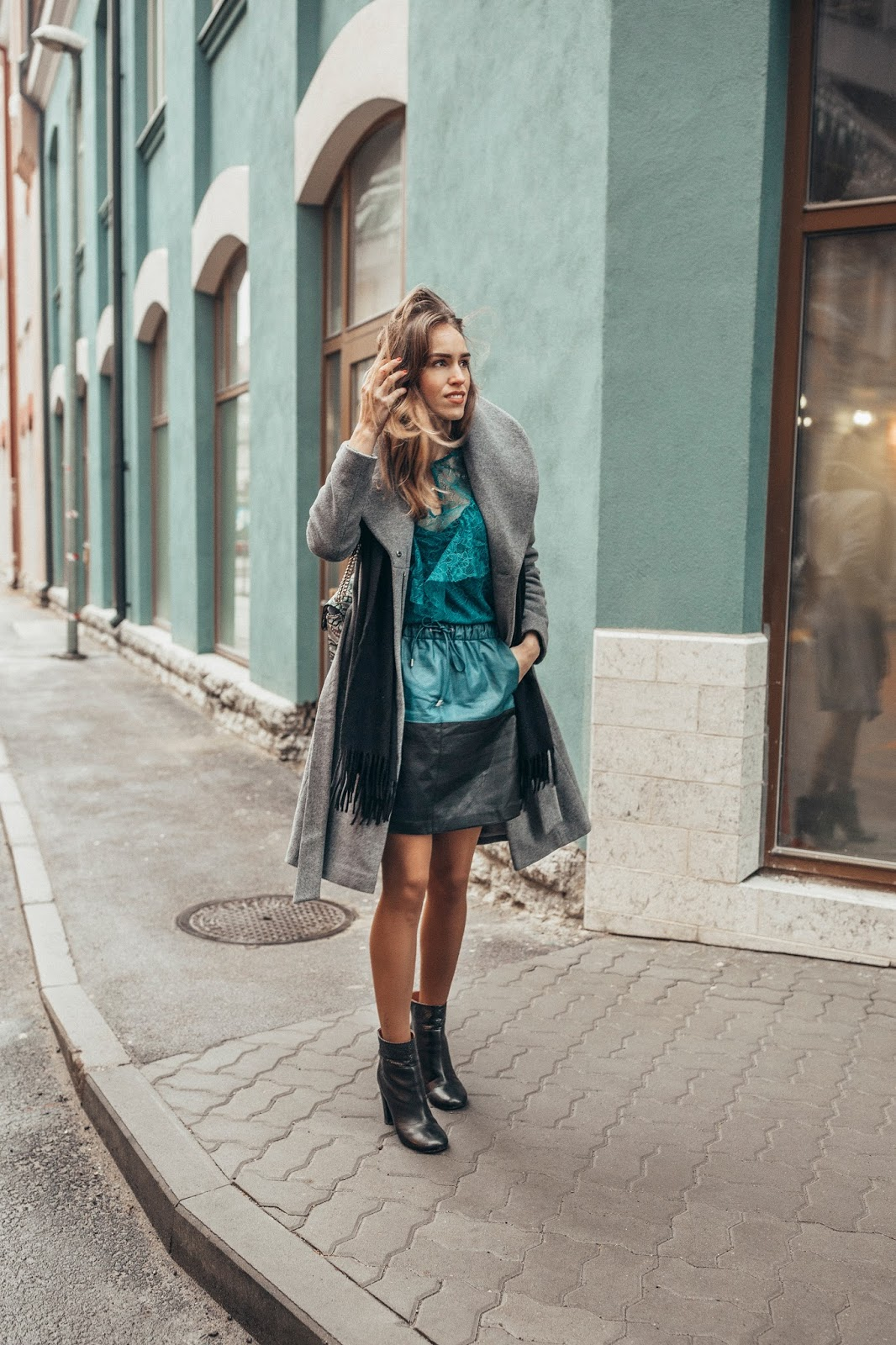 blue lace ruffle top leather skirt outfit winter