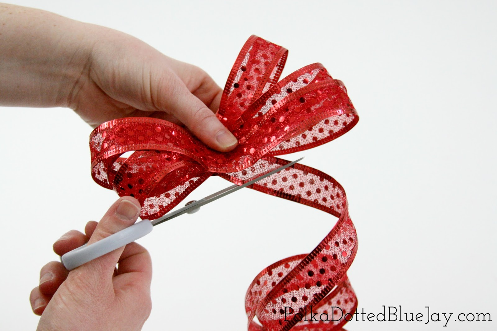 Ever wonder how to make gift wrap bows like a professional? Click here for  an