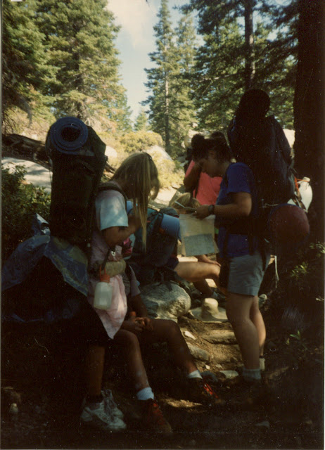 girls with packs collected at the trail