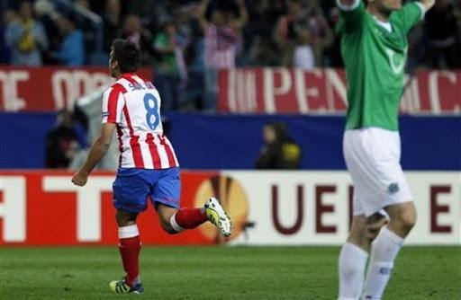 Atlético Madrid forward Eduardo Salvio celebrates after scoring against Hannover 96