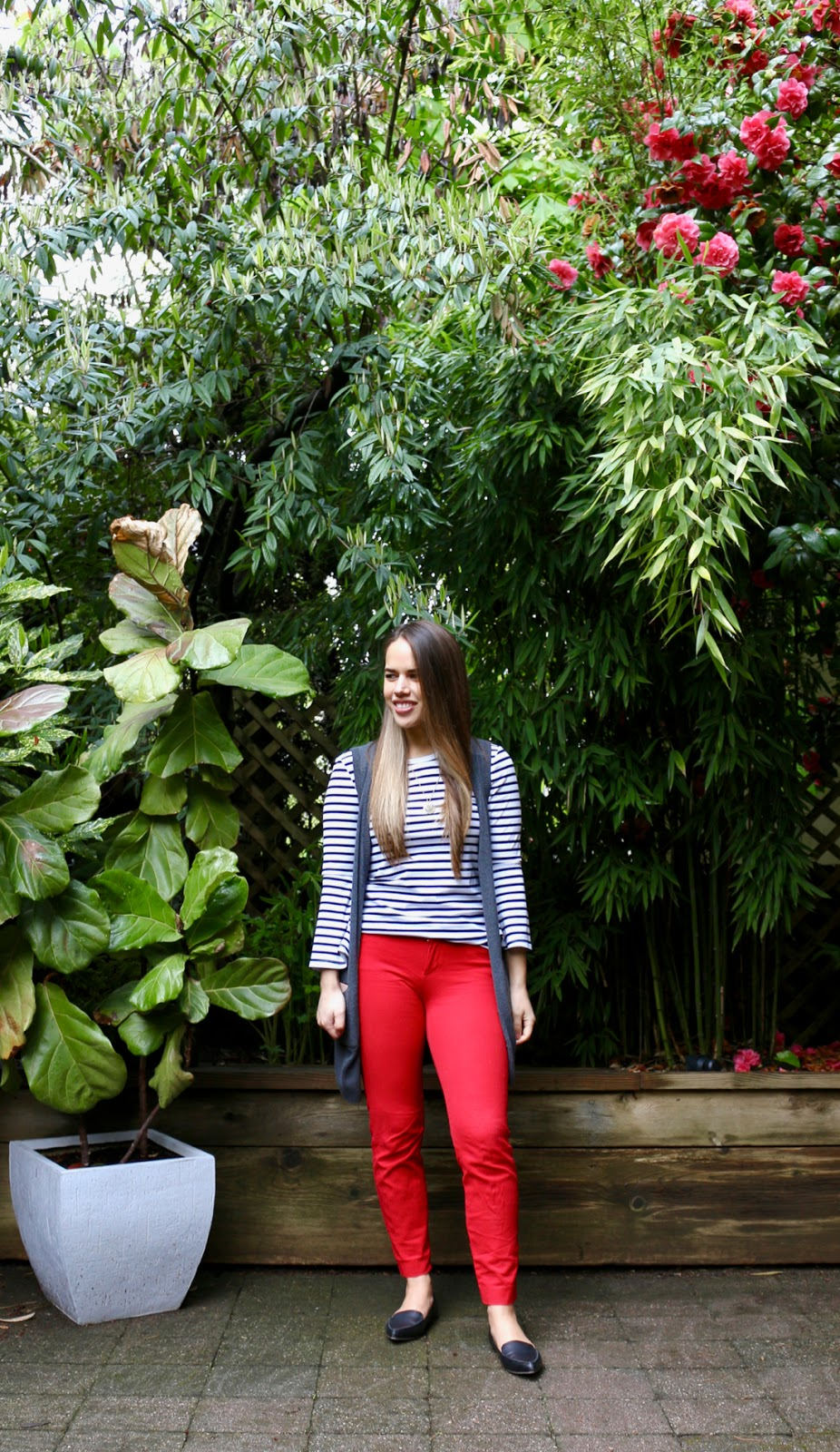 Jules in Flats - Stripe Bell Sleeve Top with Red Pants and Knit Vest (Business Casual Spring Workwear on a Budget)