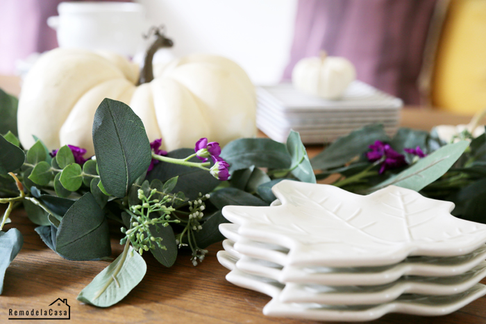 White leaf plates and white pumpkins