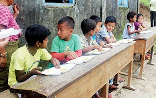 Children eat food at landslide relief camp opened at Tingling Primary School near Mirik