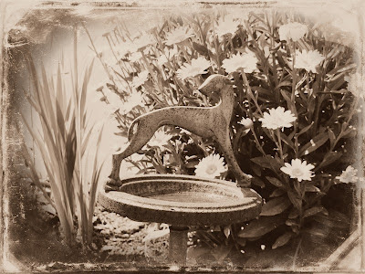 ashtray in a garden antique look