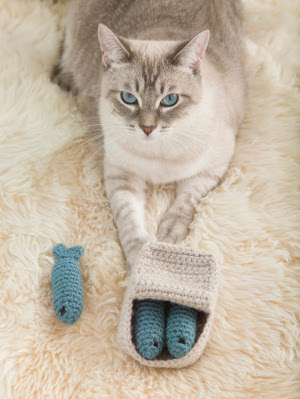 Celebrate National Pet Adoption Weekend. Make and donate an Amigurumi Sardines Cat Toy with this free pattern from Lion Brand Yarn.
