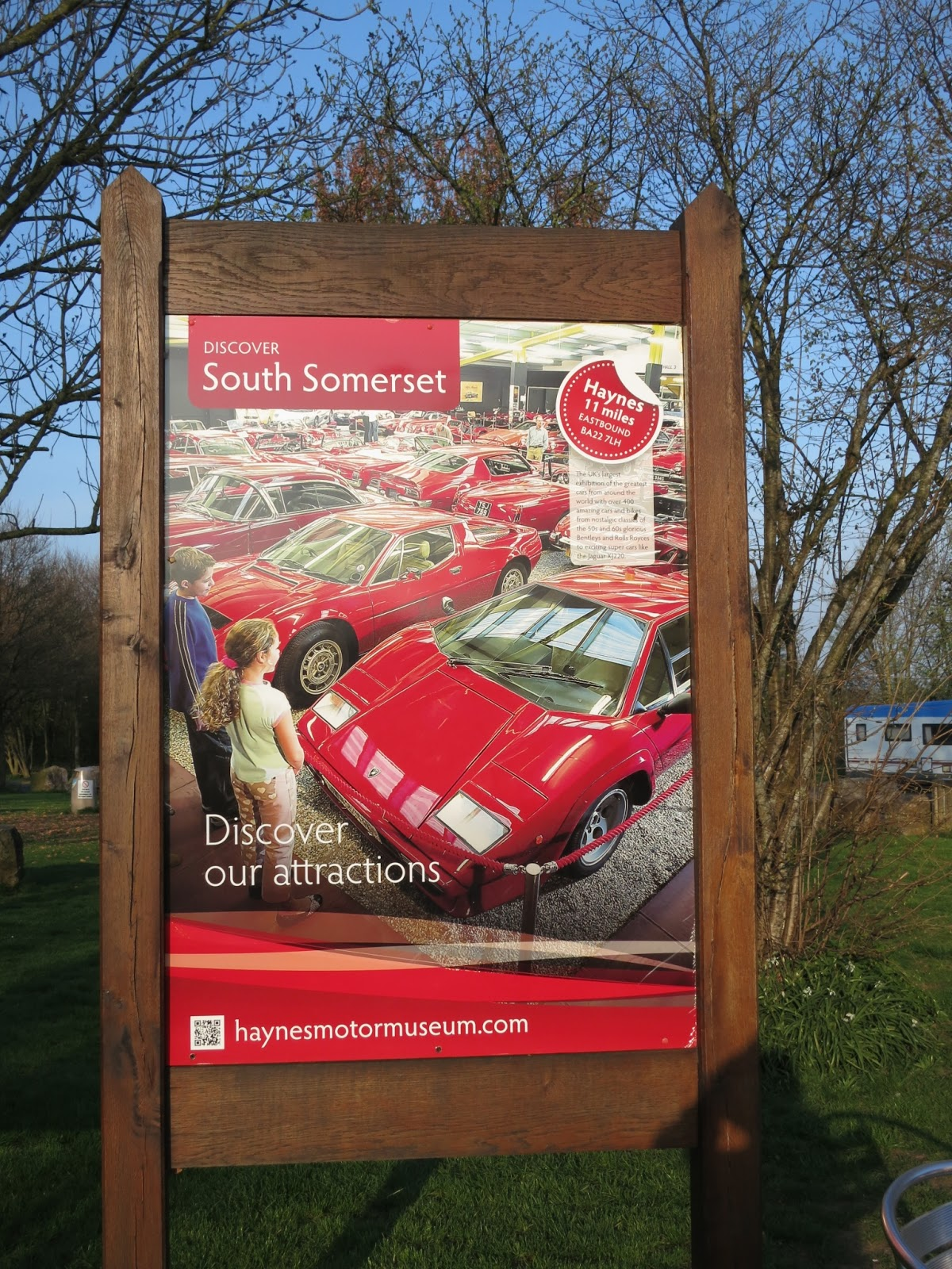 Large, free standing poster advertising Haynes Motor Museum as South Somerset visitor attraction