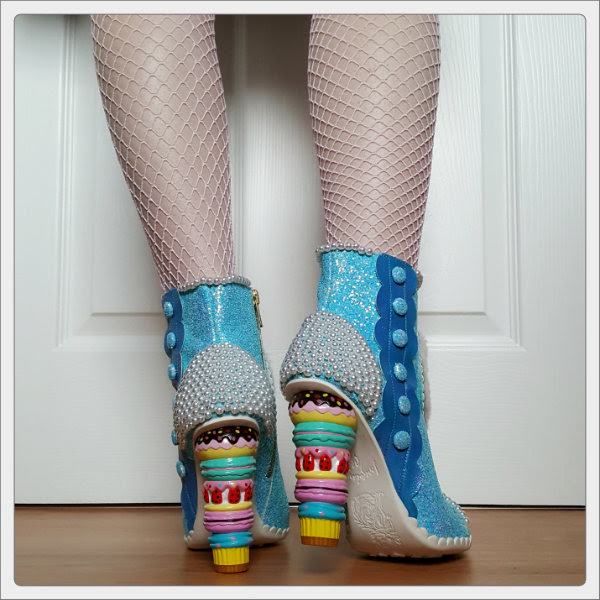 wearing Irregular Choice Bee Delicious pearl and blue glitter ankle boots