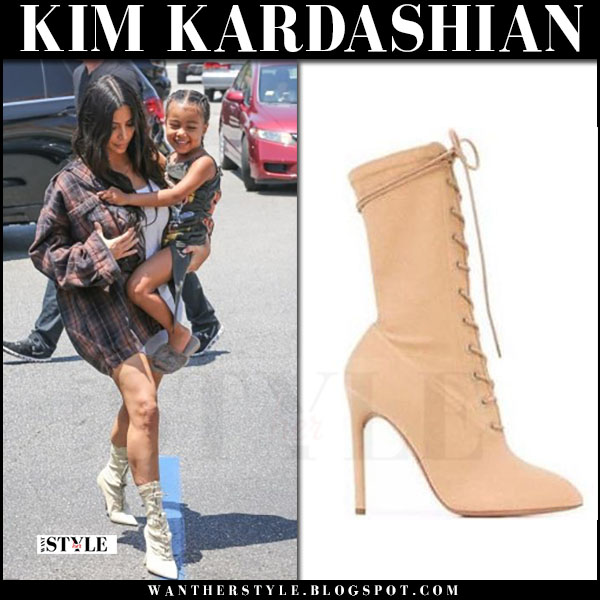 Kim Kardashian in plaid shirt and beige lace up boots yeezy what she wore june 22 2017