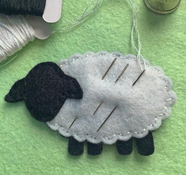 close up of felt lamb needle keeper