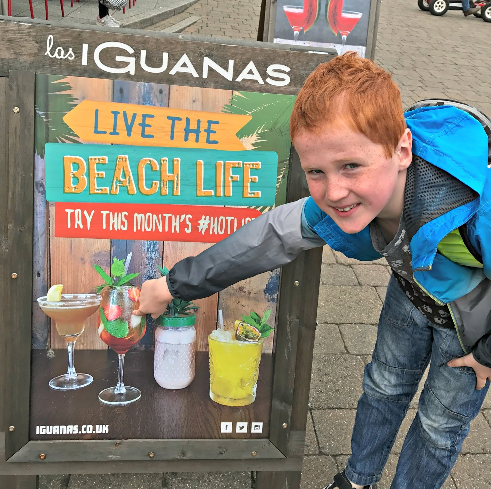 Ieuan and Las Iguanas cocktail promo board at Mermaid Quay, Cardiff