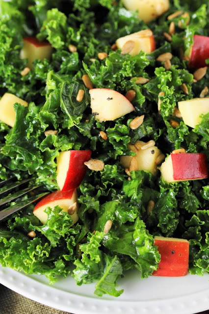 Kale is beautifully complimented by diced apple and honey in this delicious and healthy Kale & Apple Salad with Honey.