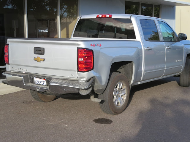Rear end damage on Chevy Silverado before repairs at Almost Everything Auto Body