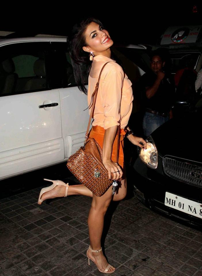 Jacqueline Fernandez Long Legs Stills In Orange Shirt Mini Short