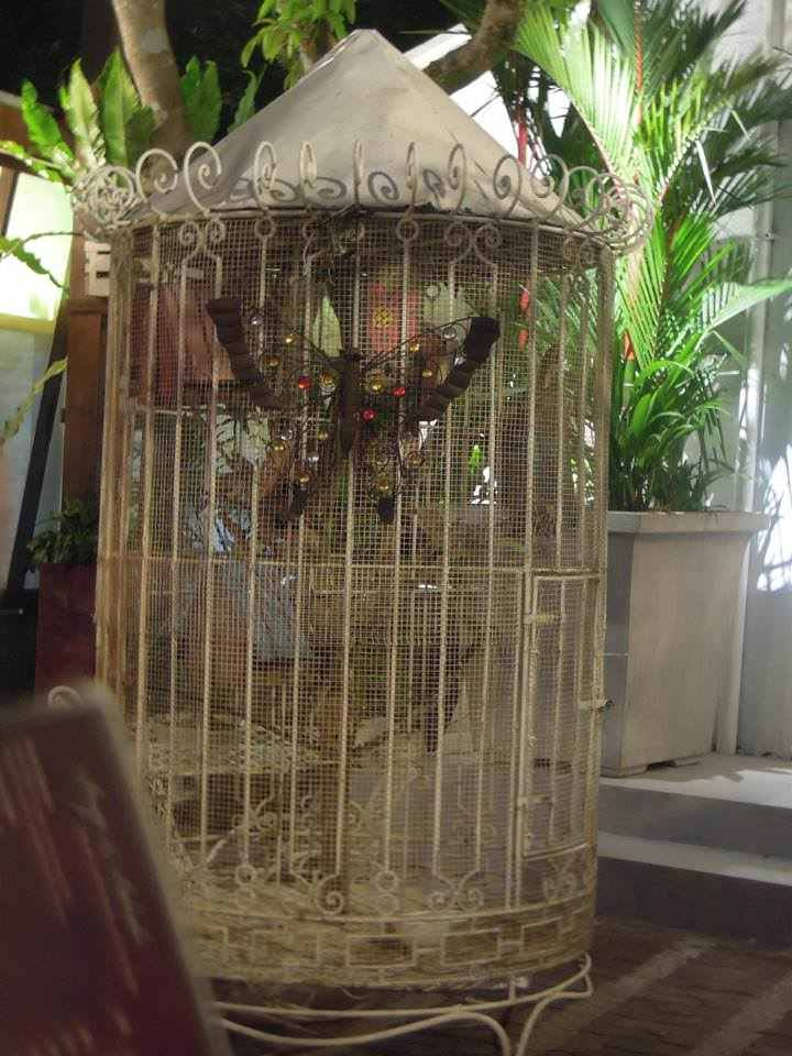 Decorative butterfly in a cage at Bag of Beans Tagaytay