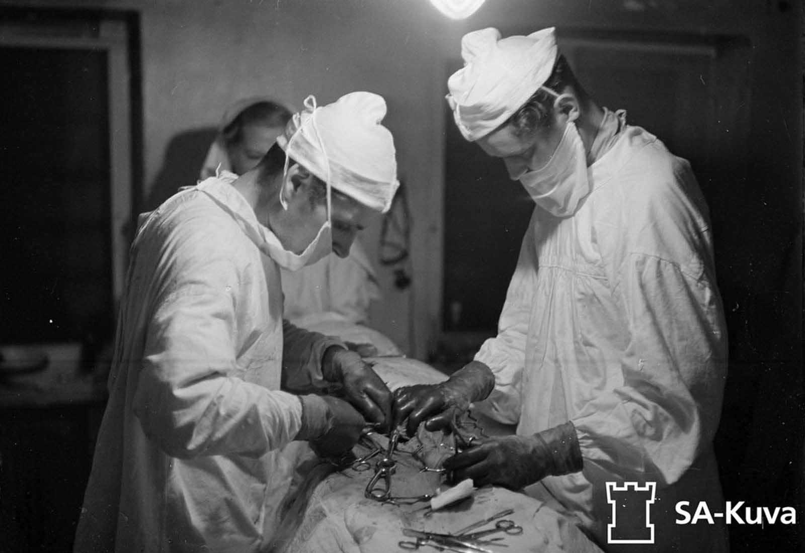 Doctors perform abdominal surgery on a wounded captain.