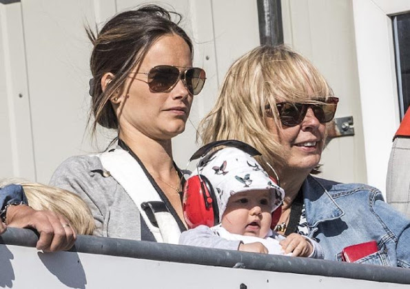 Prince Carl Philip, Princess Sofia Hellqvist and Prince Alexander of Sweden at Touring Car Championship in Karlskoga. Sofia Hellqvist Style