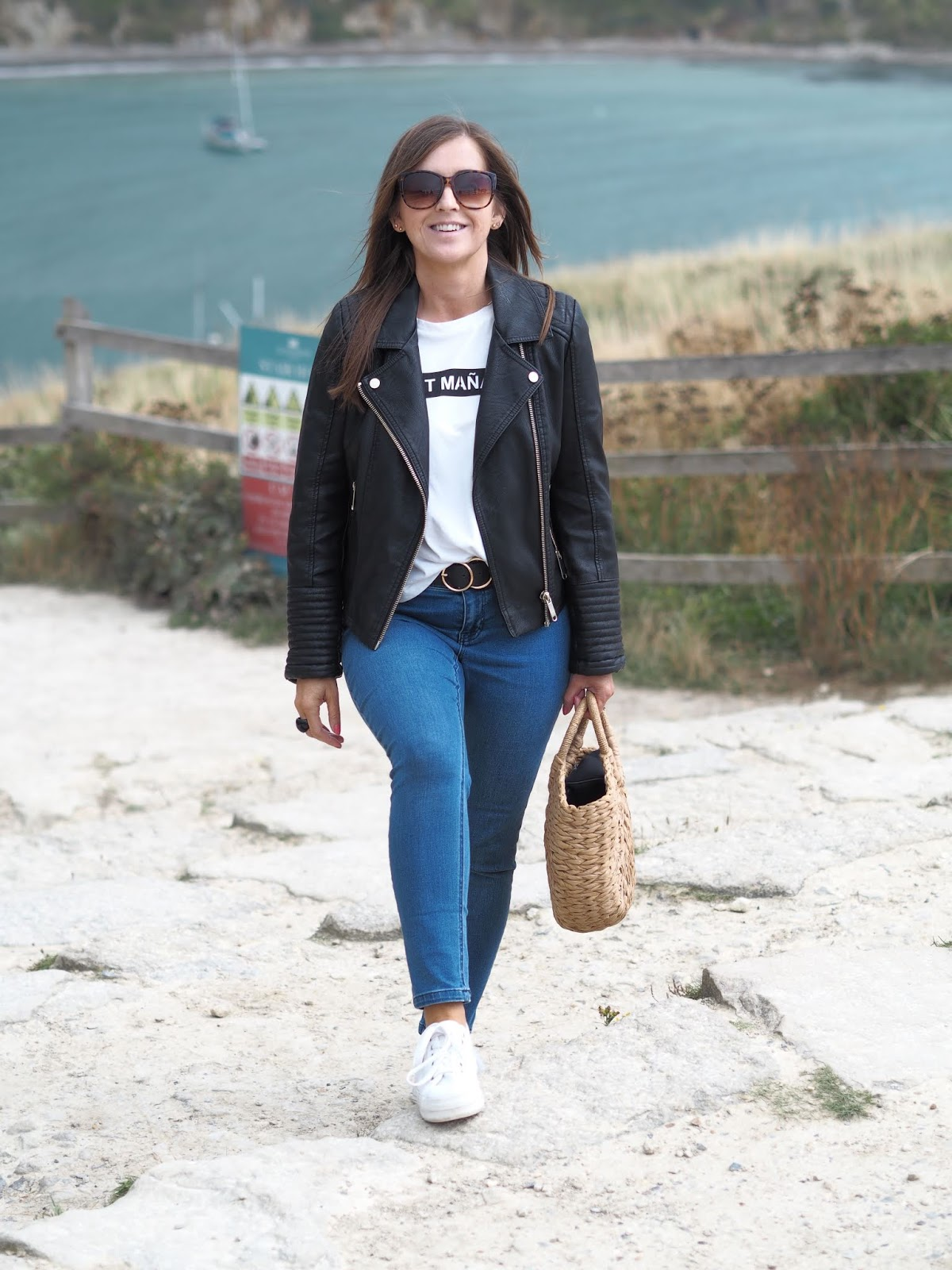 style shot at Lulworth Cove \ black biker jacket \ jeans \ Zara slogan t-shirt