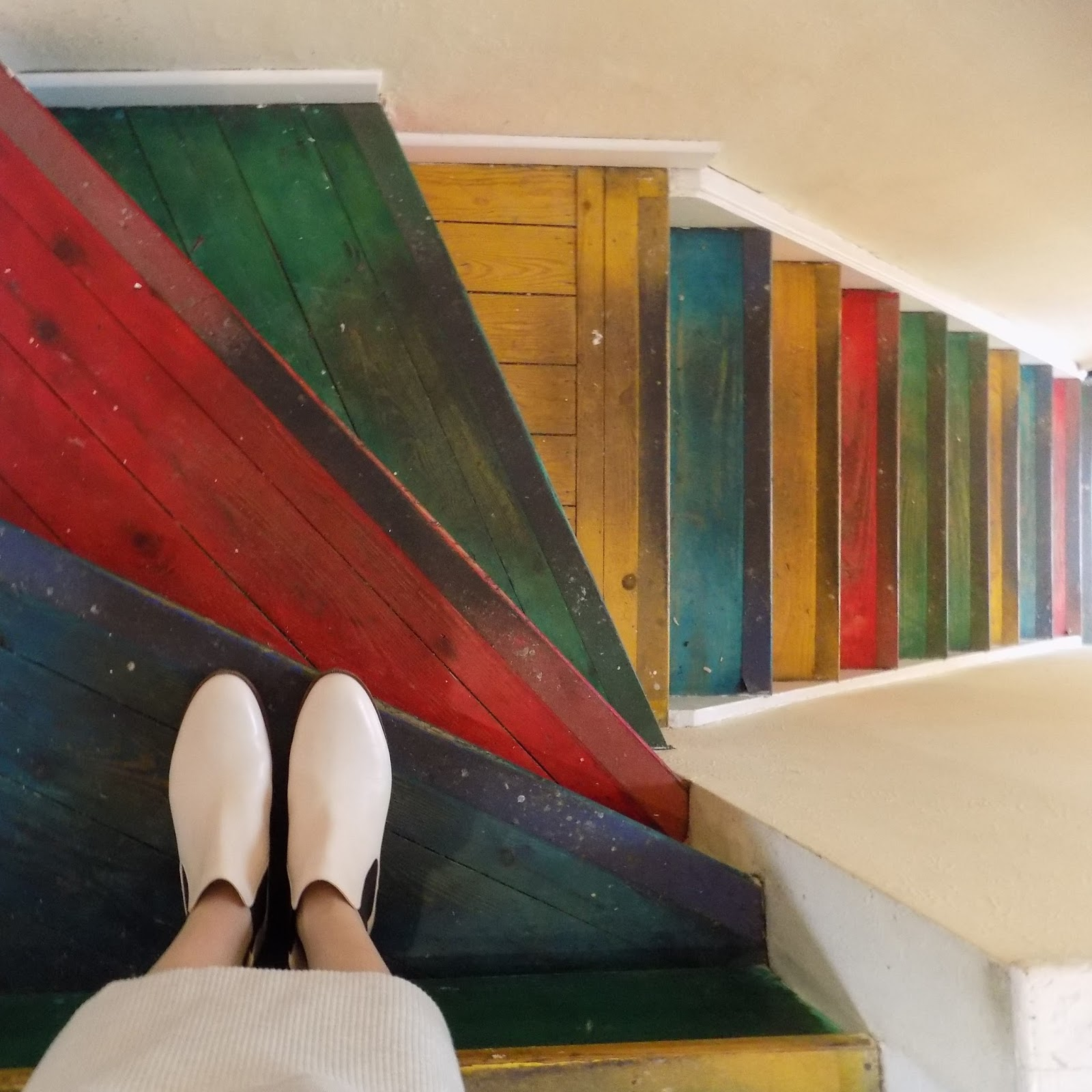Clarks pale pink Chelsea boots and bright staircase