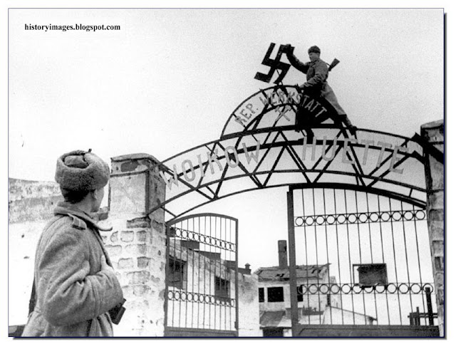 Russian soldiers remove swastika  factory  Voykova, Kerch. 1944.