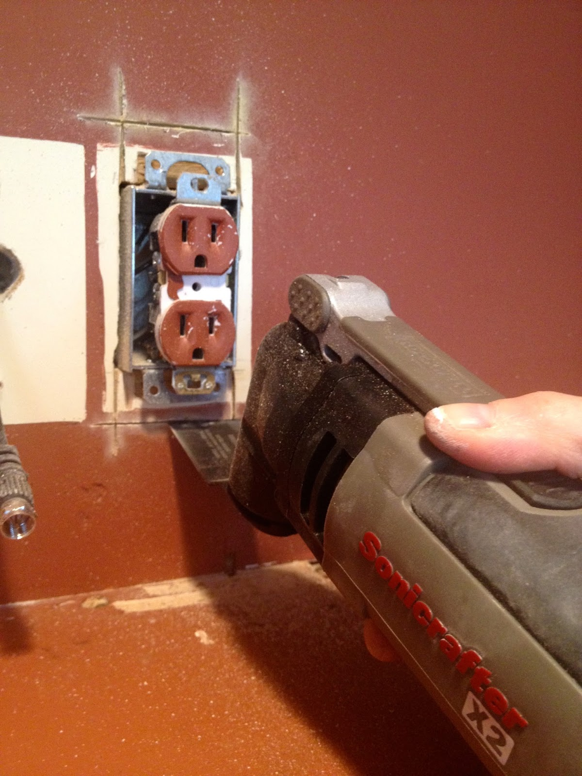 multi tool cutting an outlet