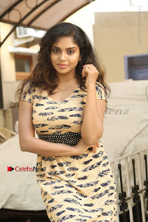 Telugu Actress Karunya Chowdary Stills in Short Dress at ATM Not Working Press Meet  0103.jpg