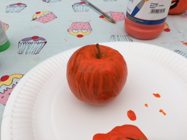 Apple painted orange