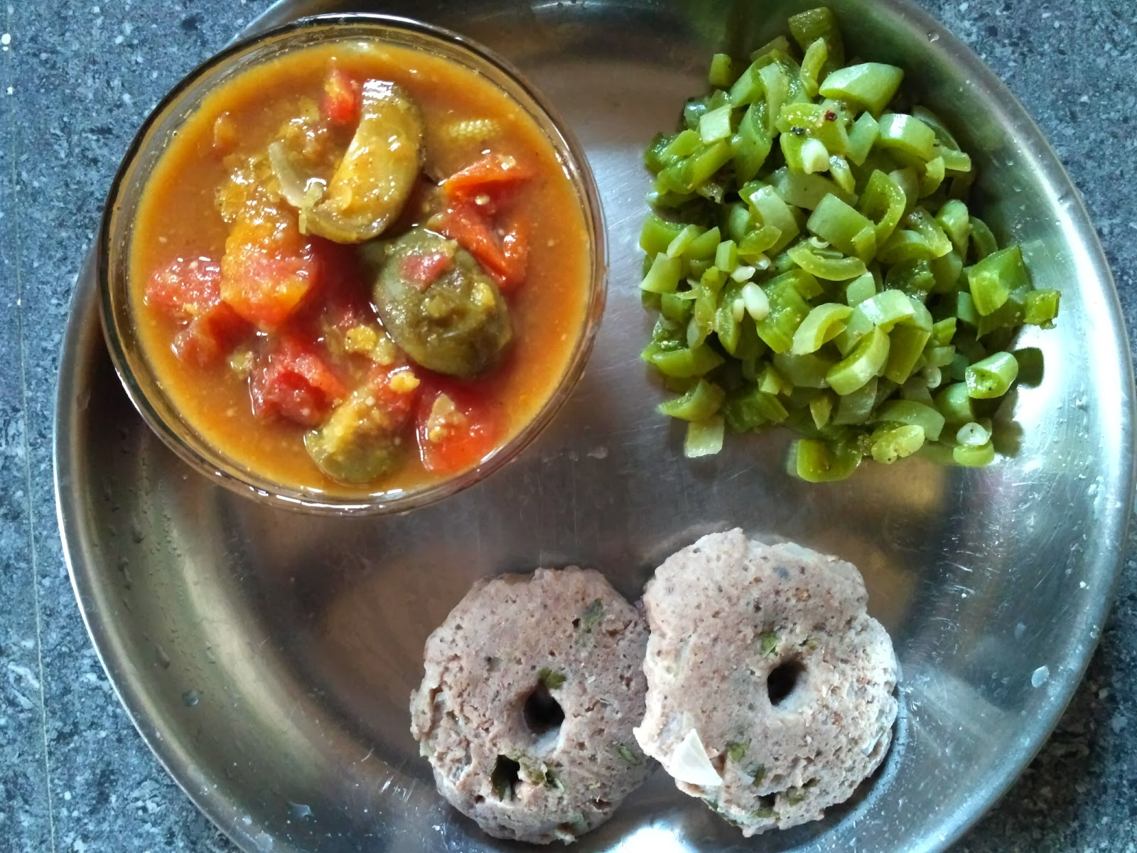 Satvik steamed vada with Sprouted Black eyed pea, Snake gourd poriyal, Brinjal sambar