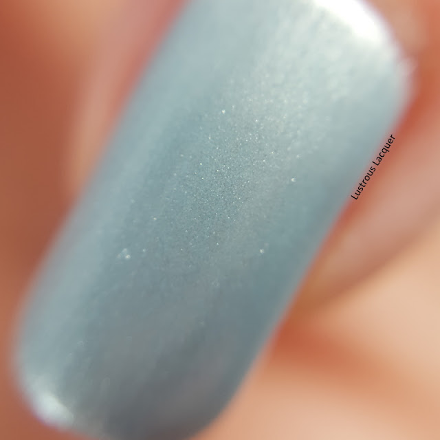 Frosty-pale-blue-nail-polish-with-silver-micro-shimmer