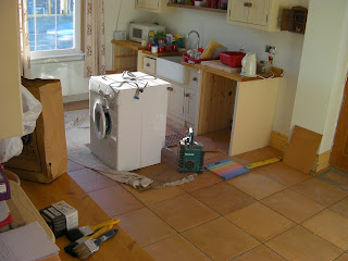 contractor refit of kitchen tiles washing machine