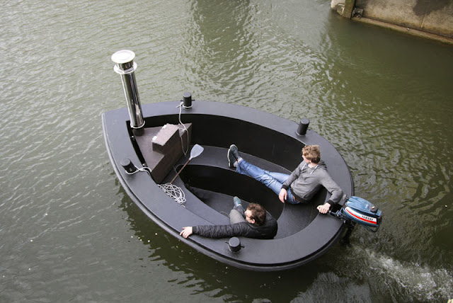 http://www.ifitshipitshere.com/the-hottug-a-motorized-floating-wood-fired-hot-tub/