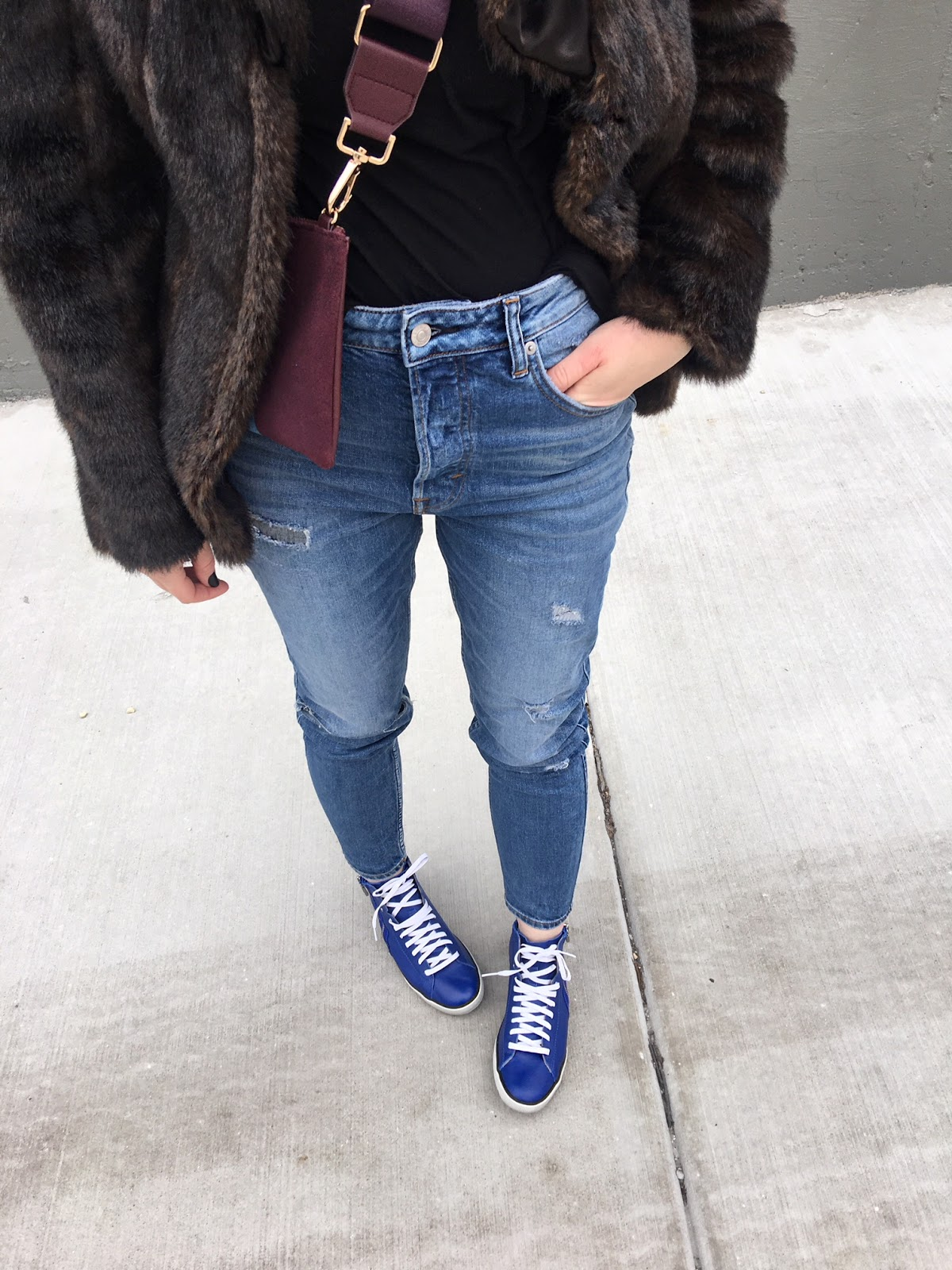 Blue sneakers & new ripped jeans