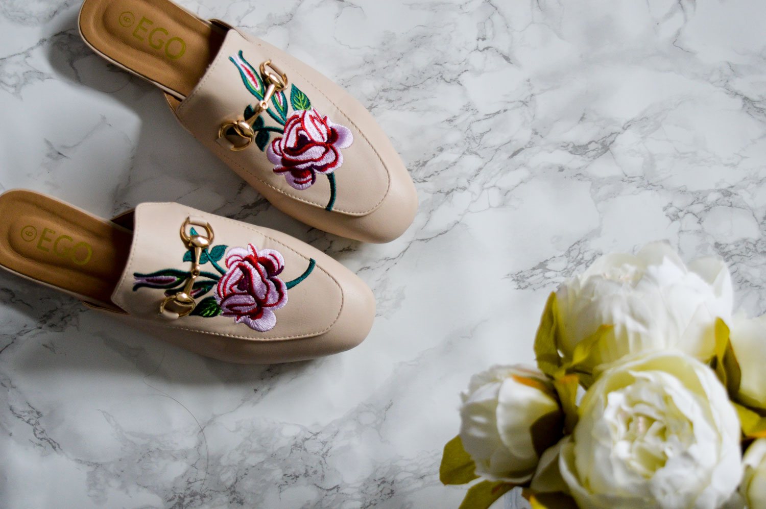These embroidered mules are uncanny dupes for the GUCCI Princetown Slippers
