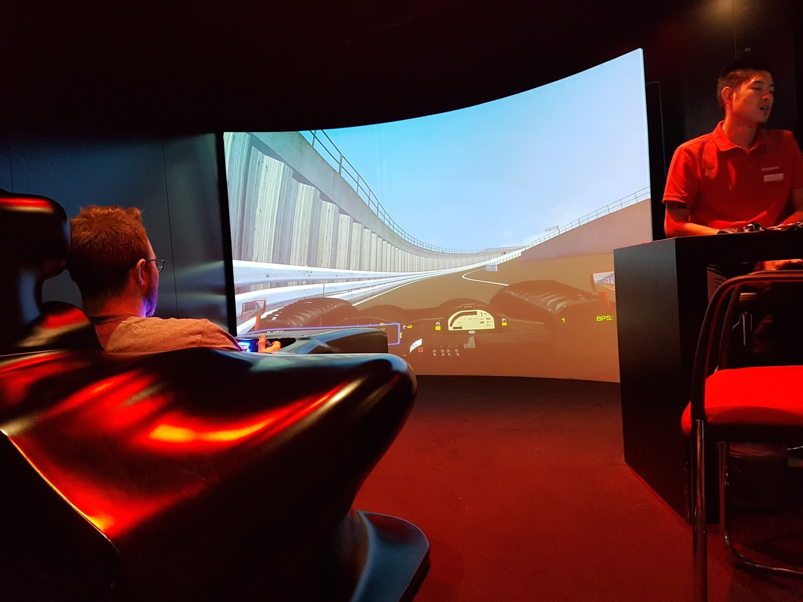 driving the race car simulation experience at nissan innovation station at the o2
