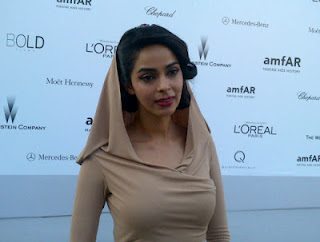 Mallika Sherawat at the Amfar gala at Cannes 2012 cream color gown stills