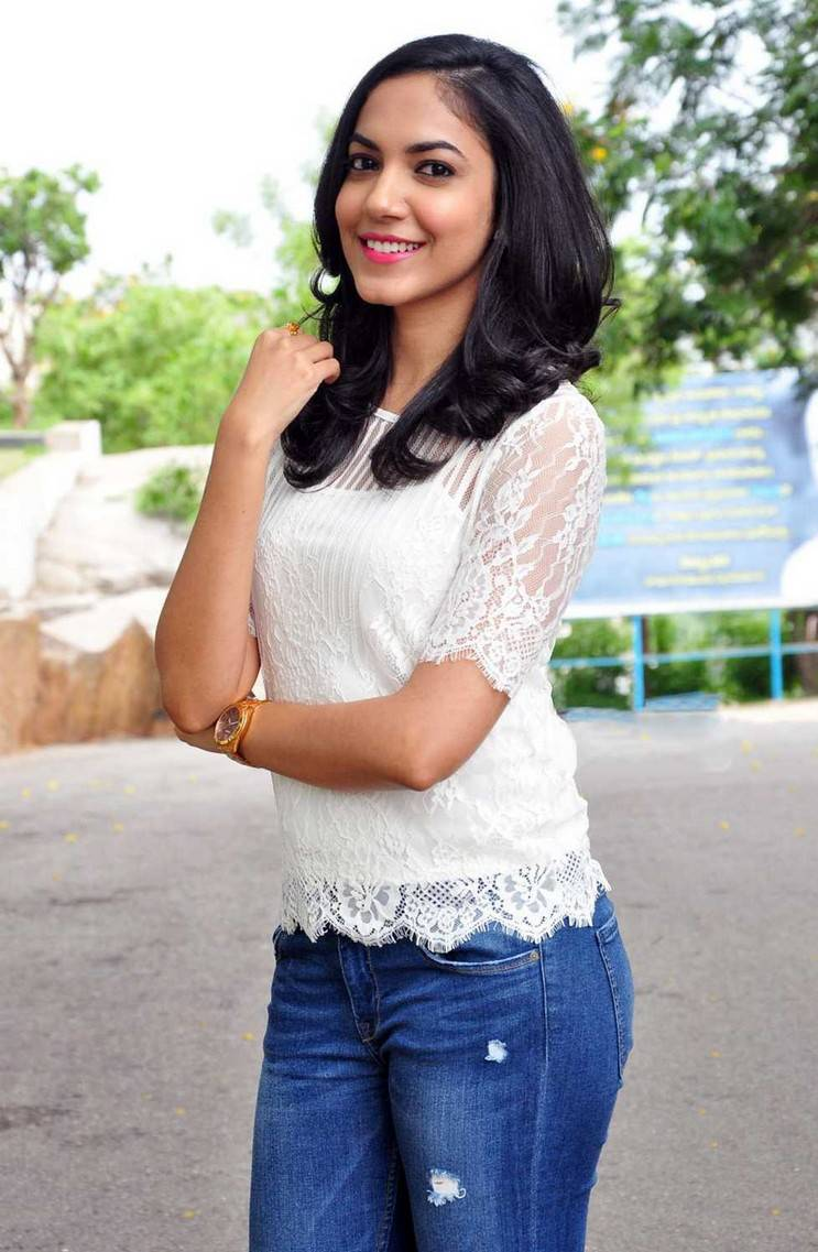 Ritu Varma Long Hair In White Top Blue Jeans